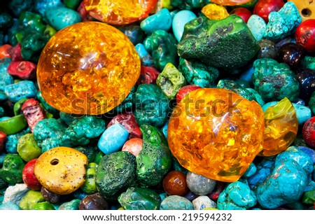 Semiprecious gemstones for sale at flea market. - stock photo