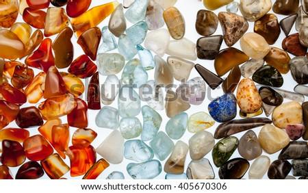 Semiprecious stones on white background - stock photo
