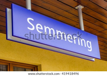 SEMMERING, AUSTRIA, OCTOBER 3, 2015: sign showing name of the railway station in semmering, part of the unesco world heritage site semmeringbahn