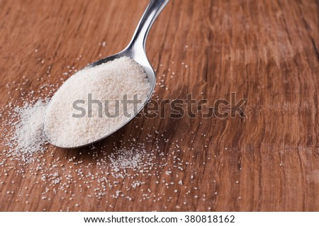 semolina photo of on metal spoon on brown wooden table