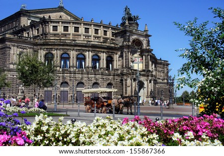 Semper Opera house and carriage with horses, Dresden, Germany - stock photo