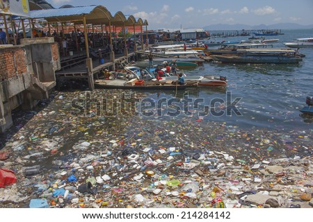 SEMPORNA, MALAYSIA - APRIL 24 2014: Plastic rubbish pollution in ocean. Photo showing pollution problem of garbage thrown directly into the sea with no proper trash collection or recycling. - stock photo