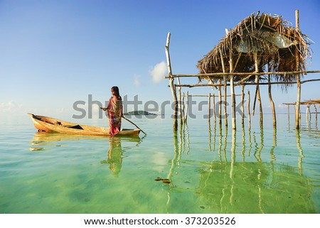 SEMPORNA, MALAYSIA - MAY 11 2015; Sea Gypsy Village girl on a boat called lepa-lepa, Sabah, Malaysia. The Bajau Laut are the sea gypsies who live in the open sea