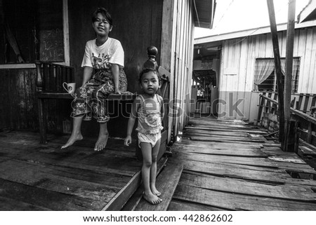 Semporna, Malaysia - May 29, 2016 : Unidentified local bajau suluk children posed for camera in Mabul Island, Sabah.