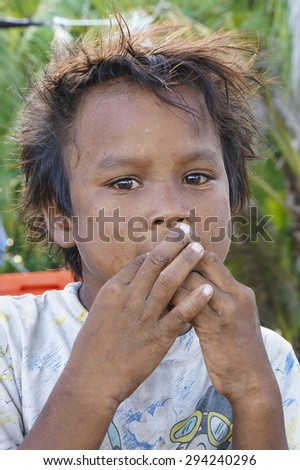 SEMPORNA, SABAH, MALAYSIA - JUNE 6: Portrait of Sea Gypsies boy on June 6th, 2014 in Semporna Island, Sabah Malaysia.  - stock photo