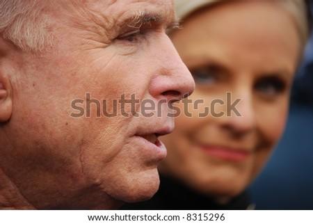 Senator John McCain, closeup with wife Cindy McCain looking at him - stock photo