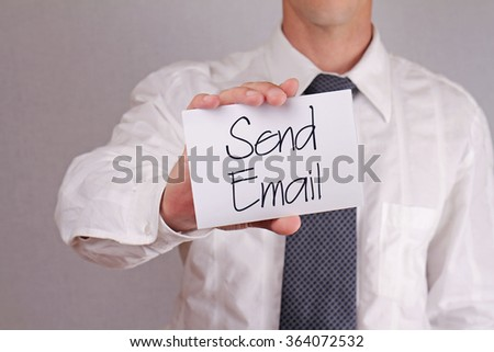 Send email, contact Us. Close up of businessman showing card.  Business and finance. Copy space image. - stock photo