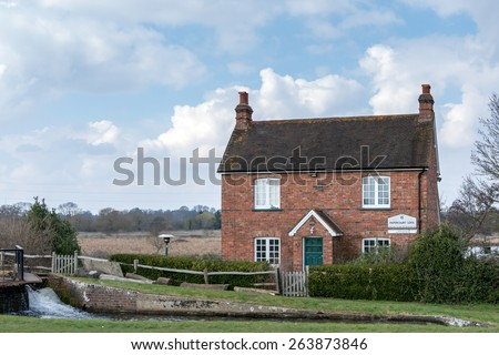 SEND, SURREY/UK - MARCH 25 : Papercourt Lock-keepers house on the River Wey Navigations Canal near Send in Surrey on March 25, 2015