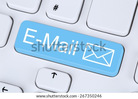 Sending E-Mail message via internet on computer keyboard with letter symbol - stock photo