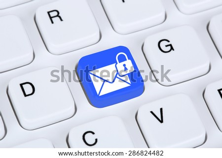 Sending encrypted E-Mail protection secure mail via internet on computer keyboard with letter symbol - stock photo