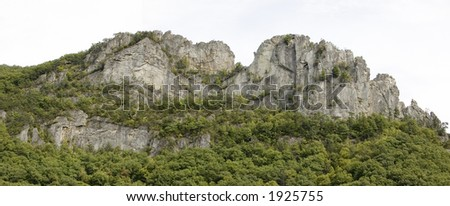 Seneca Rocks, 1 of the world's most popular places for rock climbers (tiny red speck = rock climber) - stock photo
