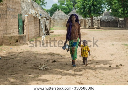 Senegal - August 19: The daily routines of a young Senegalese woman from the villages of the eastern part of Senegal. August 19,2015 in a rural areas of Senegal - stock photo