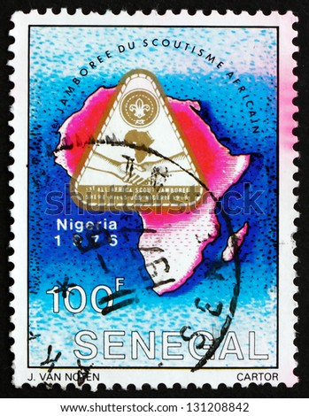 SENEGAL - CIRCA 1976: a stamp printed in the Senegal shows Jamboree Emblem and Map of Africa, 1st All Africa Scout Jamboree, Sherehills, Jos, Nigeria, circa 1976 - stock photo