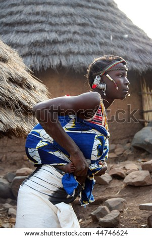 SENEGAL - FEBRUARY 15: Woman charged with child Bedic, the Bedic living on the margins of society on top of a hill with no running water or electricity, February 15, 2007 in Country Bassari, Senegal - stock photo