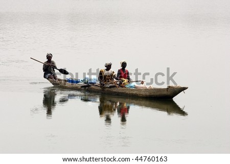 SENEGAL - FEBRUARY 18: Women navigating the Casamance River, part of the region remains awash most of the year promoting rice cultivation, February 18, 2007 in Country Bassari, Senegal - stock photo