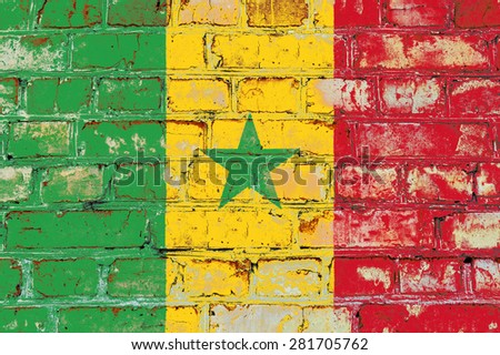 Senegal flag painted on old brick wall texture background - stock photo