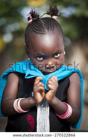 SENEGAL - November 5, 2013: Little shy Senegalese girl living on the island of Sipo in the Sine-Saloum Delta, near Toubacouta - stock photo