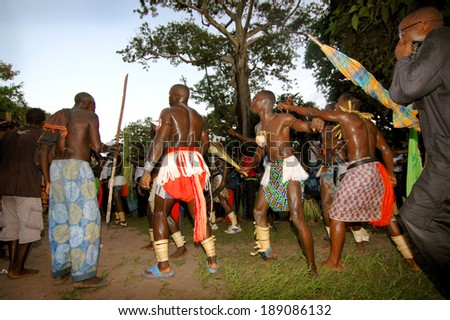 SENEGAL - SEPTEMBER 19: Men and kids in the traditional struggle (wrestle) clothes of Senegal dancing before fighting, on September 19, 2007 in Casamance, Senegal - stock photo