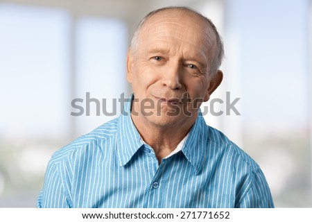 Senior Adult. Close-up of a lonely retired man - stock photo