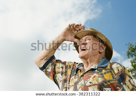 Senior adult man gazing into the distance - stock photo