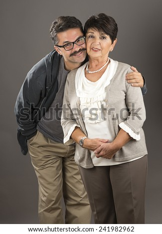 Senior Adult Woman with Her Son - stock photo