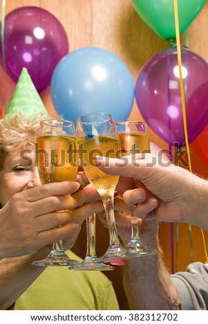 Senior adults at a party - stock photo