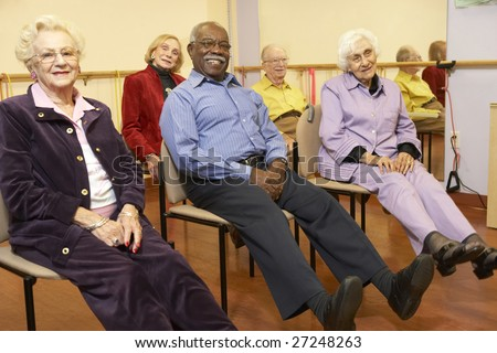Senior adults in a stretching class - stock photo