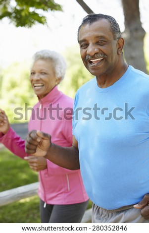 Senior African American Couple Jogging In Park - stock photo