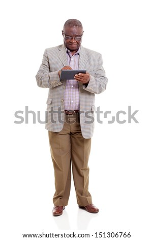senior african man using tablet computer isolated on white background