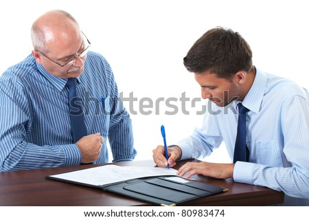 senior and junior businessman discuss and argue over something during their meeting, younger one sign contract or some documents, isolated on white - stock photo