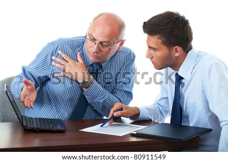 senior and junior businessman discuss something during their meeting, both look at netbook screen, isolated on white - stock photo