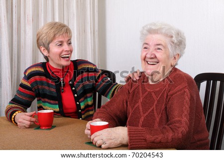 Senior and mature womans drinking caffee and laughing - stock photo