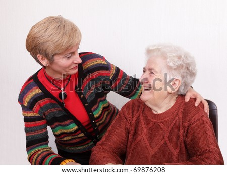 Senior and mature womans speaking  and laughing - stock photo