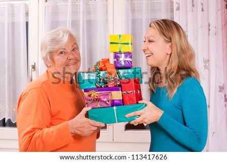 senior and young female holding gifts