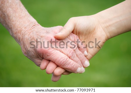 Senior and Young Women Holding Hands - stock photo