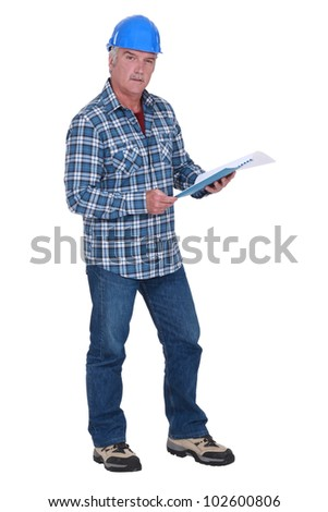 Senior architect reading through document - stock photo