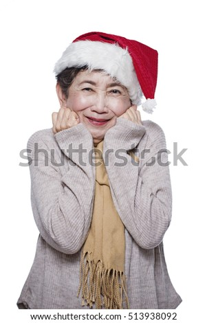 Senior asian woman chilling in cold christmas. Isolated in white background.