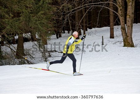 senior at the cross-country skiing in winter - stock photo