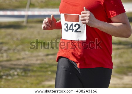 Senior athletic runner on a cross country race. Outdoor circuit. Horizontal