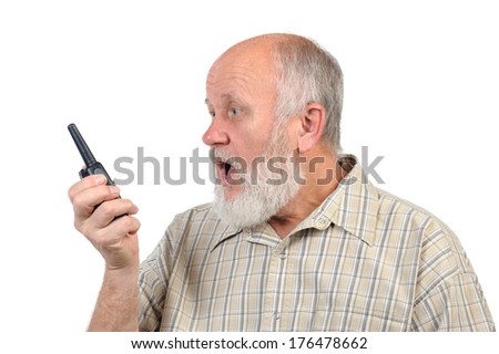 senior bald man talking to walkie-talkie, with mouth open