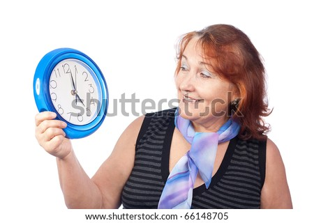 Senior beautiful woman holding a round clock - stock photo