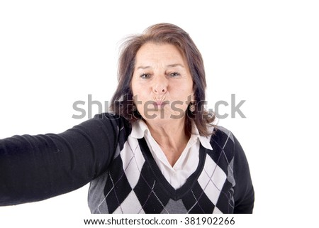 senior beautiful woman talking a selfie