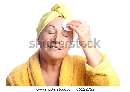 Senior beautiful woman wearing yellow towel - stock photo