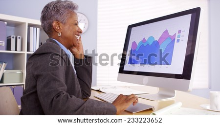 Senior black businesswoman working in office - stock photo