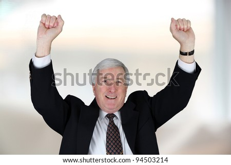Senior business in blue suit smiling at office - stock photo