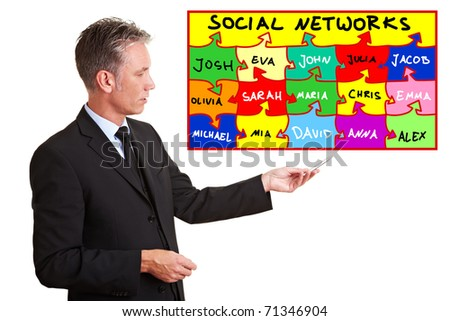 Senior business man explaining social networks with a chart - stock photo