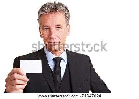 Senior business man holding an empty white business card - stock photo