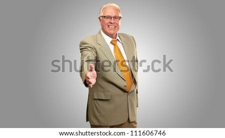 Senior Business Man Offering Handshake Isolated On gray Background - stock photo
