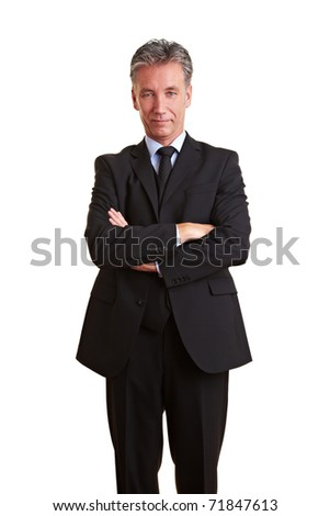 Senior business man with grey hair and his arms crossed - stock photo