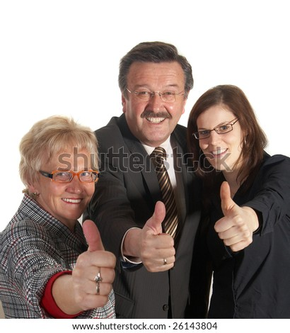 Senior business team with a young female worker giving thumbs up sign! - stock photo